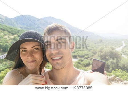 Happy Traveling Couple Making Selfie Mountains Background , Sunny Summer Colors, Romantic Mood. Happ