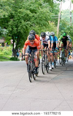 STILLWATER, MINNESOTA - JUNE 18, 2017: Cyclists on course at the 2017 North Star Grand Prix Men's Stillwater Criterium. It is the final stage of a six-stage annual race event.