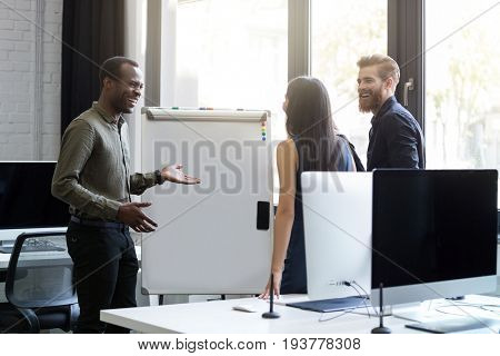 Business people having a board meeting and discussing new ideas in an office