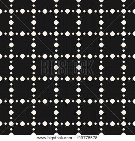 Polka dot pattern. Black subtle dotted texture. Seamless pattern. Abstract monochrome background with different small circles in square geometric grid. Design pattern, textile pattern, covers pattern, digital pattern, web pattern.