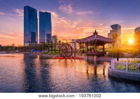 Traditional And Modern Architecture Of Seoul City In Sunset, Central Park In Songdo International Bu