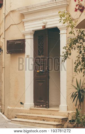 Background Texture Of Parts Of Buildings, Elements Of Architecture Doors. The Old Front Door To The