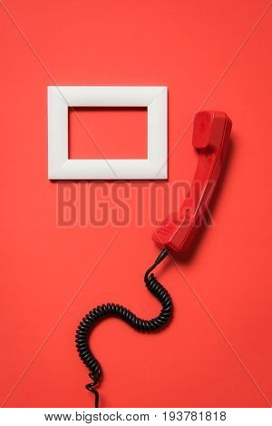 Close-up View Of Vintage Telephone Handset And White Frame Isolated On Red
