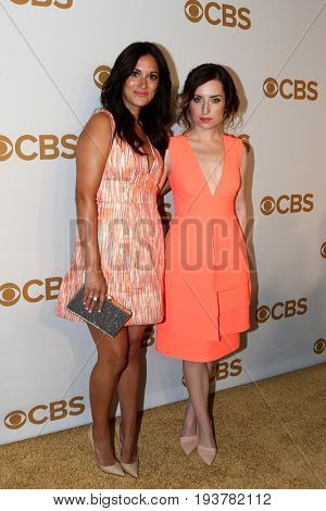 Actress Angelique Cabral (L) and Zoe Lister Jones attend the 2015 CBS Upfront at The Tent at Lincoln Center on May 13, 2015 in New York City.