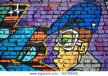 Detailed Image Of Color Graffiti Drawing. Background Street Art Background With A Painted Character.