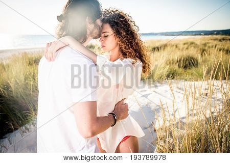 Young couple sharing happy and love mood on the beach