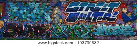 A Detailed Image Of The Graffiti Drawing. A Conceptual Street Art Background With A Colorful Letter