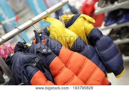 Winter children jackets on hangers in a store