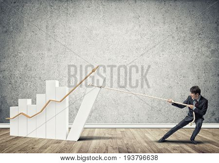 Young man and growing graph presenting growth progress