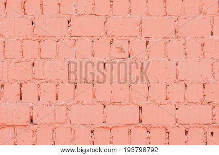 Vintage dyed brick wall with cracks, background and texture, natural design, patterns, extured background with space for copy text.