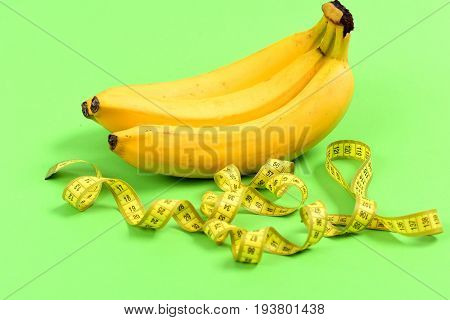 Tape For Measuring Untwisted Curly Near Bunch Of Bananas