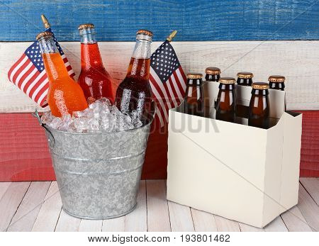an ice bucket full of soda and a six pack of beer against a patriotic red white and blue background. Perfect for Memorial Day and 4th of July themed projects.