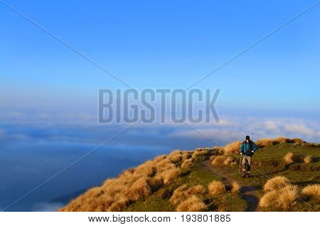 Single Traveler man above the clouds. Mountain Landscape in Himalaya. Nepal, Annapurna region, Mardi Himal track.