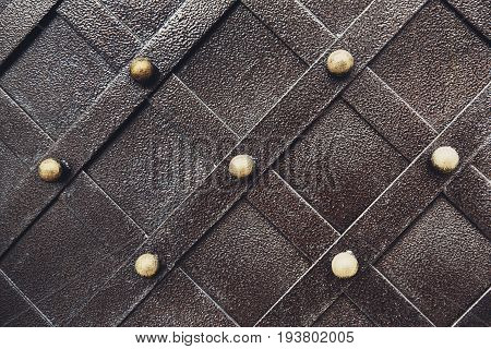 Vintage metal texture pattern of medieval gate. Decorative grunge checkered iron surface background. Architectural detail