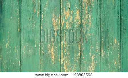 Green wooden lumber plank rustic with peeling paint texture. Can use for background.