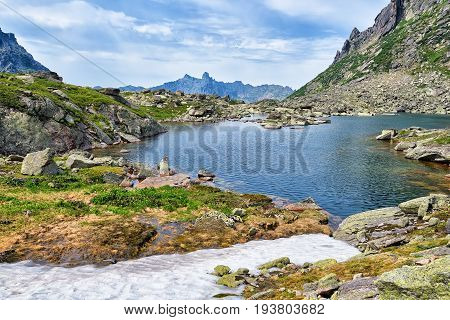 Mountain Lake In Hanging Valley And Melting Snow