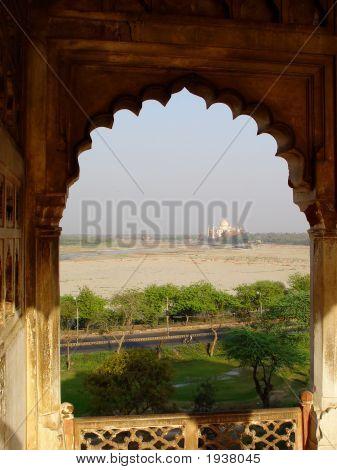 Taj Mahal In Window On Horizon. Agra Fort. India.