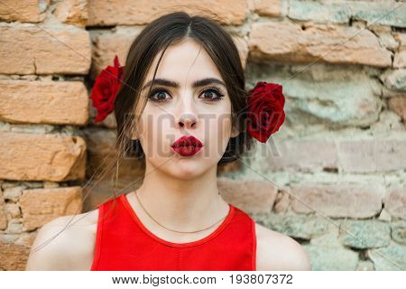 Fashion Model With Red Lips And Fresh Roses In Hair