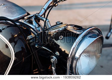 Close-up view on retro motorcycle headlights .