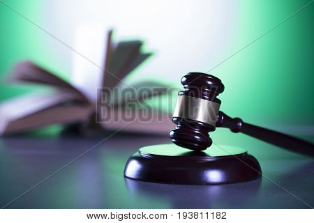Gavel, scale of justice and books, symbols of law and justice.