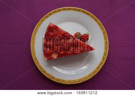 A Piece Of Delicious Strawberry Cake With Jello And Strawberries Lying On A Beautiful Plate, Top Vie