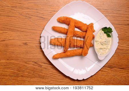 Homemade Fried Mozzarella Sticks with Marinara Sauce.