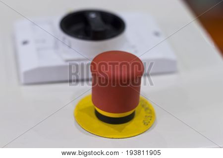 Security push switch;emergency stop button;shut down;white background;selective focus