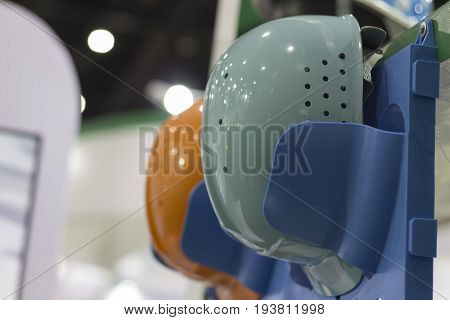 Safety helmets on a shelf ; Working Hard Hat;Personal Protection Equipment PPE