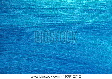 Background painted of blue nacreous color. Abstract background.