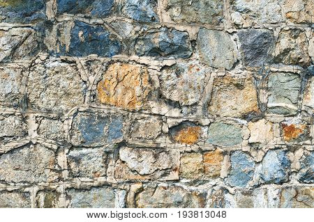 Ancient wall is made of stone background