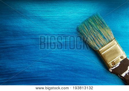 A Brush On A Blue Nacreous Color Painted Background. Abstract  Background.
