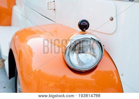 Headlight of old american car 50s .