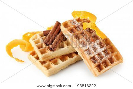Delicious cinnamon waffles with orange zest isolated on white