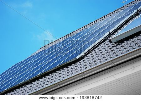 Solar photovoltaic panel on the rooftop under blue sky