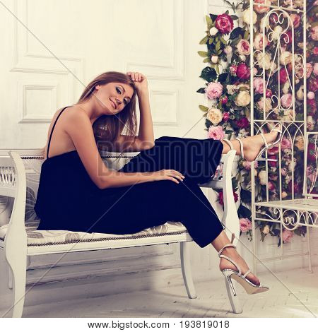 Beautiful Romantic Woman Sitting And Posing On The White Bench In Fashion Black Dress And Trendy Sho