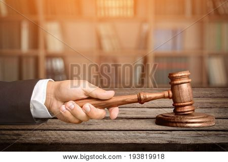 Wooden male hand wood hammer judge table