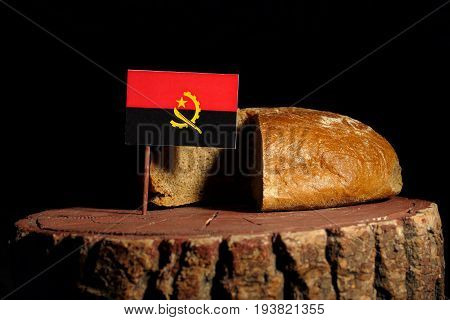 Angolan Flag On A Stump With Bread Isolated