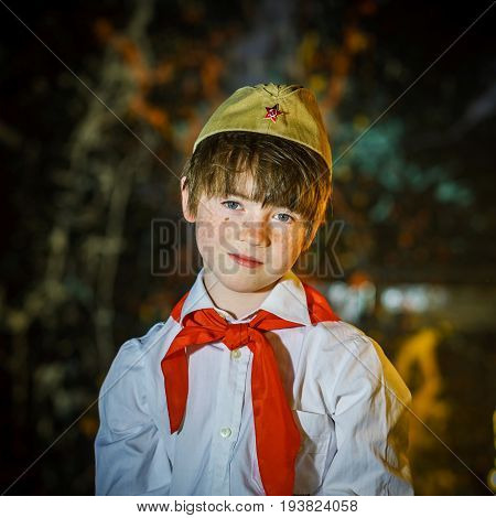 Redhead Attractive Boy Dressed Like Soviet Pioneer With Red Tie And Garrison Cap