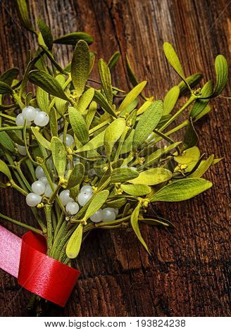 mistletoe branch on an old wooden table