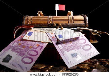 Bahraini Flag On Top Of Crate Full Of Money