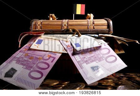Belgian Flag On Top Of Crate Full Of Money