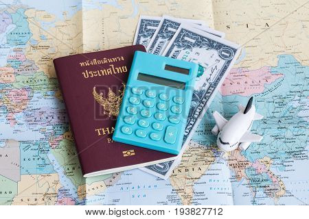 A Passport Of Thai Citizen And An Mini Airplane Model On A Map