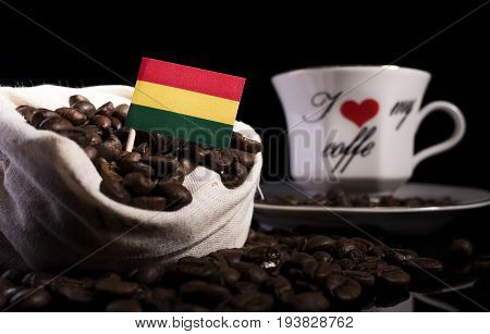 Bolivian Flag In A Bag With Coffee Beans Isolated On Black Background