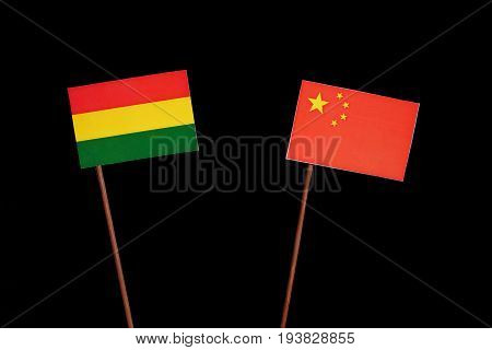 Bolivian Flag With Chinese Flag Isolated On Black Background