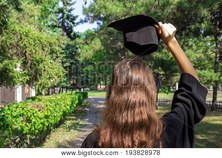 Graduation Day, Images Of Graduates Are Celebrating Graduation Put Hand Up, A Certificate And A Hat