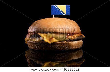 Bosnia And Herzegovina Flag On Top Of Hamburger Isolated On Black Background
