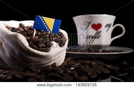 Bosnia And Herzegovina Flag In A Bag With Coffee Beans Isolated On Black Background