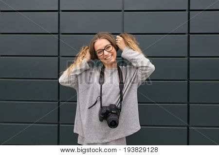 Gomel, Belarus - 24 May 2017: Girl With Glasses With Sony Camera.