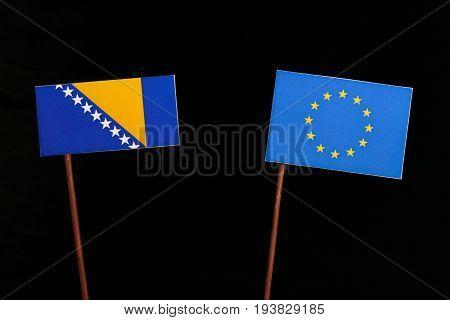 Bosnia And Herzegovina Flag With European Union (eu) Flag Isolated On Black Background