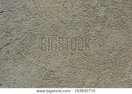 Background image of gray cement-sand plaster on the wall.